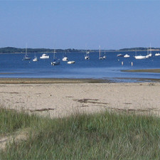 Beach shoreline with boats in distance