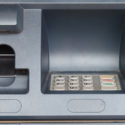 Close up of an ATM machine showing screen and keypad