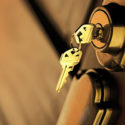 Close up of keys in a deadbolt lock on a door