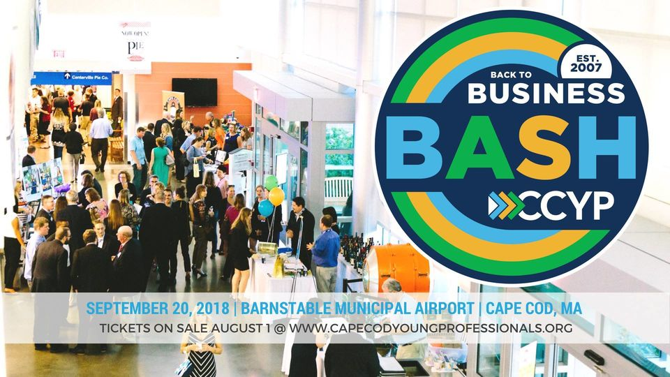 Photo of people networking inside Barnstable Municipal Airport at last year's Back to Business Bash, with the Back to Business Bash logo in the upper right quadrant of the image.