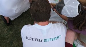 back of t-shirt with words 'positively different