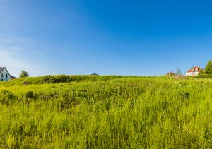 open field of land for new home construction