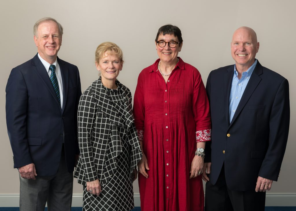 The Coop President & CEO, Lisa Oliver with three new elected Board Members, Gene Guill, Sarah Alger, and Bill Varga