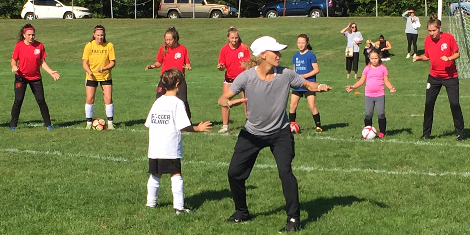 Olympic Gold Medalist Kristine Lilly teaches children on the soccer field.