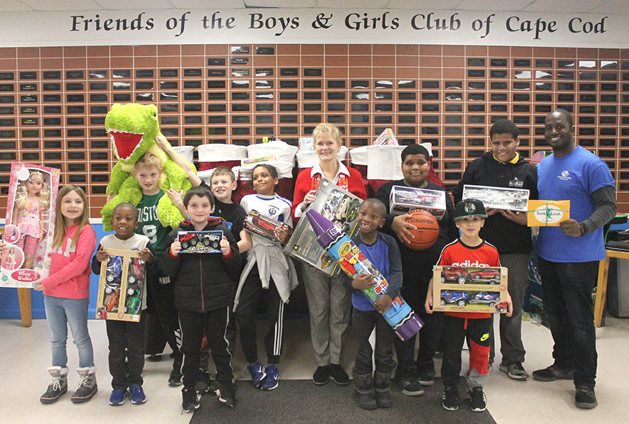 Lisa Oliver stands with children at the Boys and Girls Club of Cape Cod.