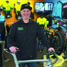 Tim Alty, owner of Bike Zone of Cape Cod, poses in his store