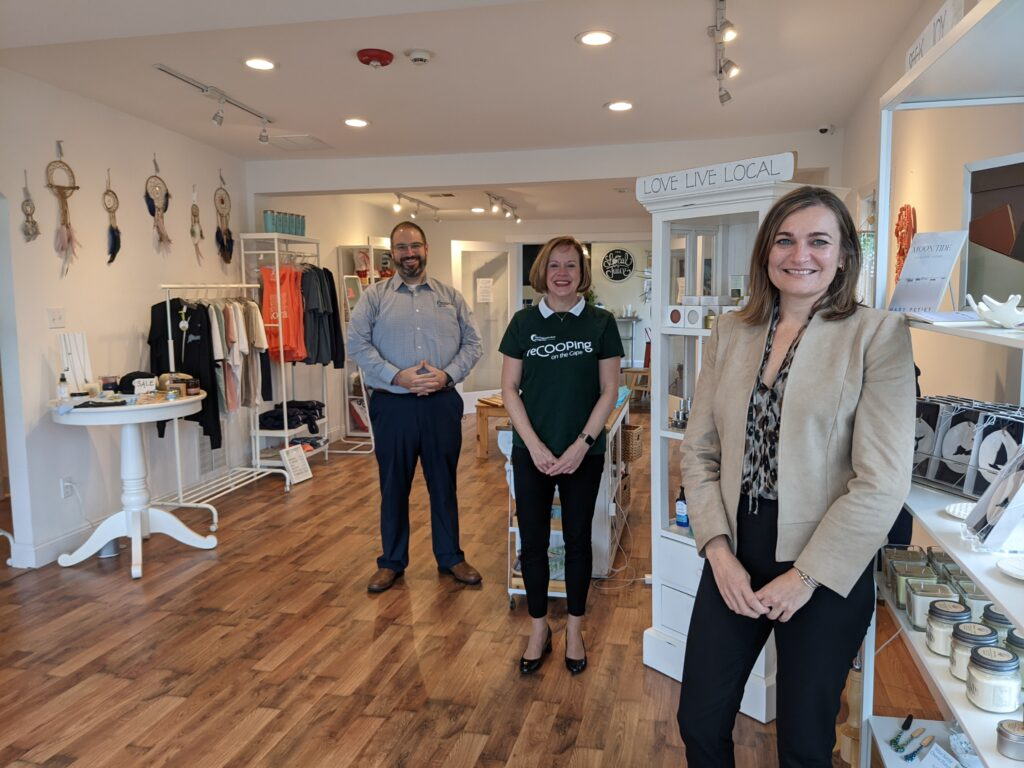 Amanda Converse, CEO and founder of Love Live Local, right stands in the Love Live Local store, 539 South St., Hyannis, with John Cooke, Coop Marketing Officer, and Sheryl Walsh, Coop Chief Consumer & Small Business Banking Officer