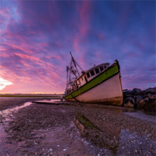 Image of boat in the ocean during low tide